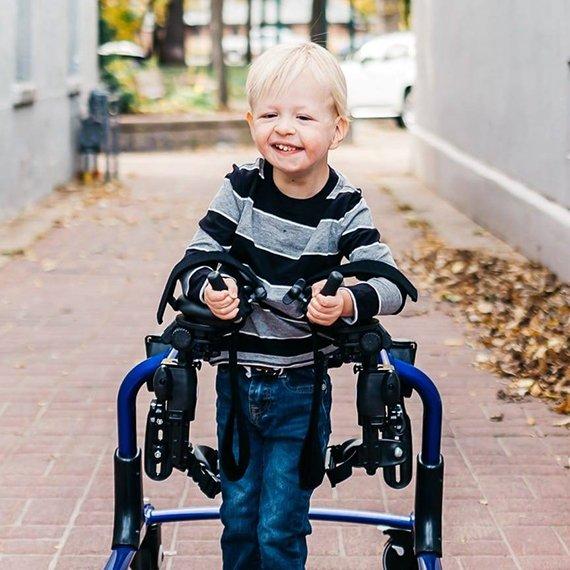 Children walking with adaptive equipment